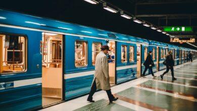 metro station with passengers on platform